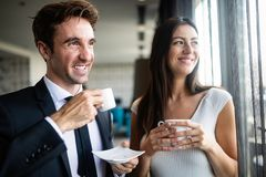 Young couple of professionals chatting during a coffee break royalty free stock image