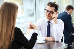 Young couple of professionals chatting during a coffeebreak Stock Photo