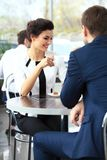 Young couple of professionals chatting during a coffeebreak. Young couple of professionals chatting during a coffee break stock image
