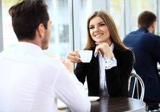 Young couple of professionals chatting during a coffeebreak. Young couple of professionals chatting during a coffee break royalty free stock photo