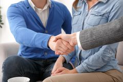 Young couple with psychologist family therapy handshake close-up stock images