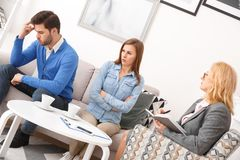 Young couple with psychologist family therapy husband disappointed by wife stock photos