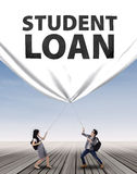 Young couple pulling student loan banner Royalty Free Stock Image