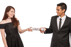 Young Couple Pulling a Xmas Cracker. Stock Photography