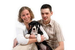Young couple and puppy Royalty Free Stock Photos