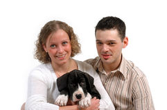 Young couple and puppy. Young smiling couple and a their sweet puppy Stock Photos