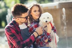 Young couple with puppy. Stock Photos