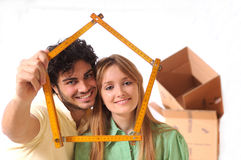 Young couple purchase new home. Happiness and look in camera Royalty Free Stock Image