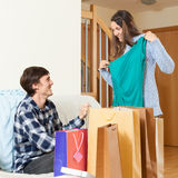Young couple with purchases. In home Royalty Free Stock Photos