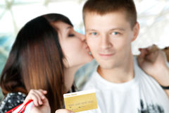 Young couple with purchases in shopping mall Royalty Free Stock Images