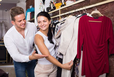 Young couple purchasing dress and blouse Royalty Free Stock Images