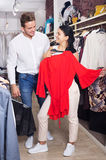Young couple purchasing dress Royalty Free Stock Photos