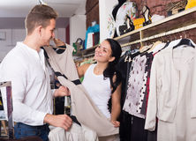 Young couple purchasing jacket and dress Stock Photos