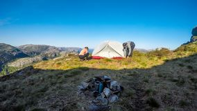 A couple building up a tent in the wilderness in Norway. stock images