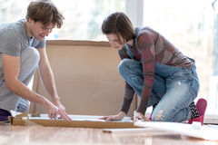 Young couple putting together new furinture Stock Images
