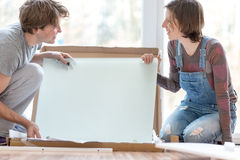 Young couple putting together self assembly furniture Royalty Free Stock Images