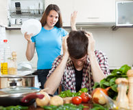Young couple during quarrel in kitchen Royalty Free Stock Photos