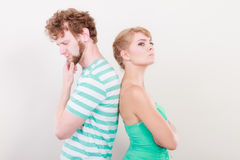 Young couple after quarrel offended back to back Royalty Free Stock Photos