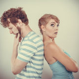 Young couple after quarrel offended back to back Stock Photography
