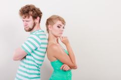Young couple after quarrel offended back to back. Bad relationship concept. Man and women in disagreement. Young couple after quarrel offended back to back, not royalty free stock photos