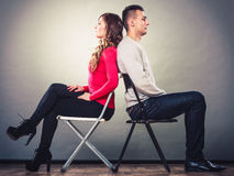 Young couple after quarrel sitting back to back Stock Photography