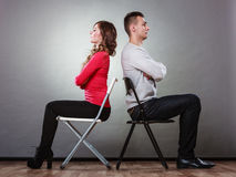 Young couple after quarrel sitting back to back Royalty Free Stock Photography