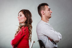 Young couple after quarrel sitting back to back Royalty Free Stock Photos