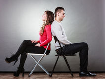 Young couple after quarrel sitting back to back Royalty Free Stock Image