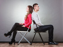 Young couple after quarrel sitting back to back Stock Images