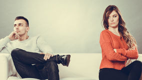 Young couple after quarrel sitting on sofa Stock Photography