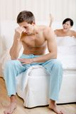 Young couple argues in bed Stock Images