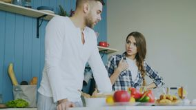 Young couple quarrels in the kitchen at home