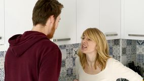 Young Couple Quarrels in the Kitchen. Man and Woman Scream in Frustration and Angrily Gesticulate stock footage