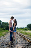 Young couple on rail tracks Stock Photo