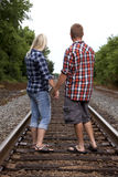 Young Couple on railroad tracks Stock Images
