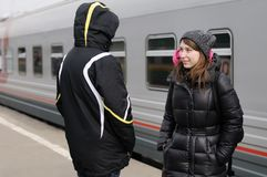 Young couple on railway station platform Stock Photos