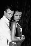 Young couple in the rain Royalty Free Stock Photos