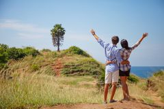 Young couple with raised hands royalty free stock photography