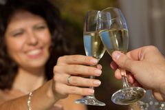 Young couple raising wedding toast Stock Photo