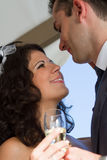 Young couple raising wedding toast Stock Images
