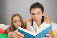 Young couple reading royalty free stock photos