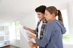 Young couple reading blueprint Royalty Free Stock Photo