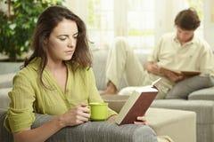 Young couple reading book Stock Photos