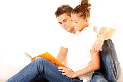 Young couple reading a book Royalty Free Stock Images