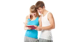 The young couple is reading a book. Isolated on a white background Stock Images