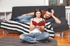 Young couple reading a book Royalty Free Stock Photography