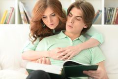 Young couple reading book. Portrait of a young couple reading book together Royalty Free Stock Photo