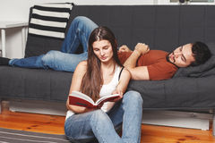 Young couple reading a book Royalty Free Stock Photo