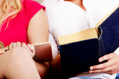 Young couple reading a books together Royalty Free Stock Images