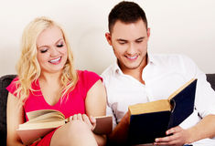 Young couple reading a books together Royalty Free Stock Image